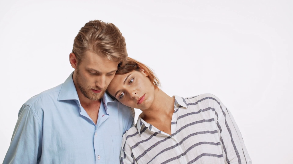 young-caucasian-couple-standing-in-fake-sadness-on-white-background-in-slowmotion-she-rested-head-on-his-shoulder-then-they-smile-and-laugh_hw46wncux_thumbnail-full01.png